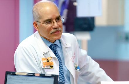 Dr. Roy Vega, Director, Pediatric Emergency Medicine, at nurse's station in Pediatric ER.