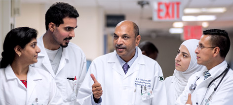 Dr. Sindhaghatta Venkatram, Director, Graduate Medical Education/Attending, Pulmonary and Critical Care (center), instructing Internal Medicine Residents (L to R):  Dr. Anisha Vupputuri, Dr. Shehriyar Mehershahi, Dr. Maram Khalifa, and Dr. Ivan Ortiz.