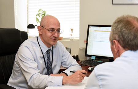 Dr. Andreas Evdokas, Administrative Director, Department of Psychiatry, counseling patient.