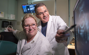 Dr. Barry Karpel, Director, Maternal Fetal Medicine, and Jeanne Harris, Ultrasound Supervisor, OB/GYN, reviewing patient sonogram.