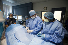 Dr. Charbel Ishak, Interventional Radiologist (center), performing invasive procedure.