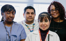 Nursing Staff, Psychiatry, Marie Dee, RN (Standing, front), with Patient Care Technicians (L to R): Beverly Ramsey, Leonardo Aquino, and Denise Hicks.