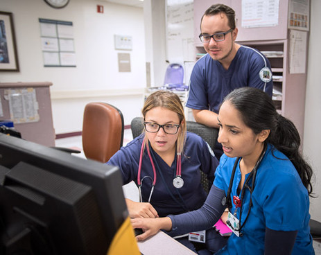 Blessy Joseph, RN (right), with nursing students, Taylor Bruns and Alexander Greszczuk, on Medical/Surgical Unit.