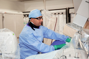 Dr. Nassim Krim, Attending, Cardiology, performing cardiac catheterization procedure.