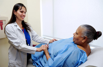 Marta Sales, Nurse Practitioner, Surgery, preparing patient for examination.