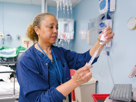 Michelle Marr-Scudder, RN, Anesthesia, preparing medication for patient.