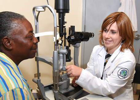 Dr. Tybee Eleff, Attending, Ophthalmology, checking vision of patient.