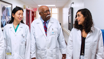 Dr. Milton Gumbs, Vice President, Medical Director (center), with former residents, Dr. Jiao Wang (left), and Dr. Heba Armoush.