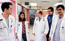 Dr. Marin Nicu, Attending, Department of Medicine (center), making rounds in Coronary Intensive Care Unit, with (L to R): Dr. Carlos Gonzales, Resident, Internal Medicine; Dr. Anupama Menon, Attending, Infectious Disease; Frederick Hernaez, medical studen